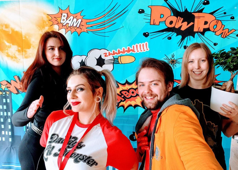 Power Plus team members in superhero costumes